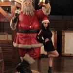 Shanti Dynamite posing for pics with a Santa Claus