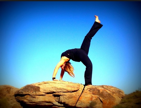 Girl performing Yoga in open
